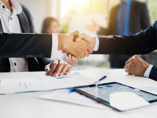 Business people making handshake, successful negotiation and agreement of partnership communication